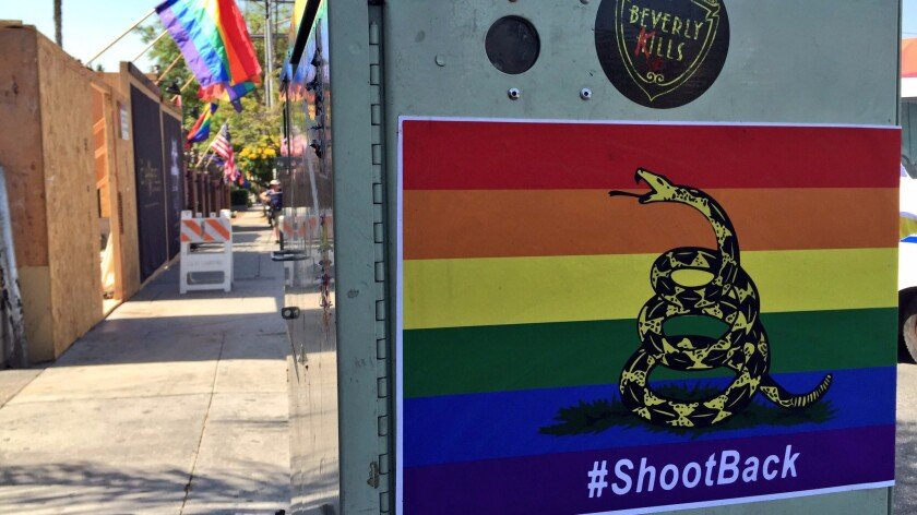 Stickers featuring a rainbow-colored version of the Gadsden flag were hanging near the Abbey Food & Bar, a well-known West Hollywood gay bar, on Thursday morning.