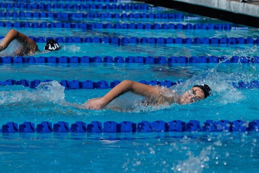 La Jolla High's Roxy Hazuka swims in the 100-meter freestyle March 20 against Academy of Our Lady of Peace of San Diego.