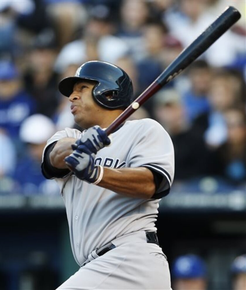New York Yankees' Vernon Wells watches his two-run home run during the fifth inning of a baseball game against the Kansas City Royals at Kauffman Stadium in Kansas City, Mo., Saturday, May 11, 2013. (AP Photo/Orlin Wagner)