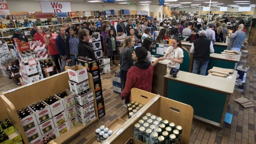 In this Wednesday, Nov. 23, 2016, photo, shoppers form lines at the Sugarhouse State Liquor store in