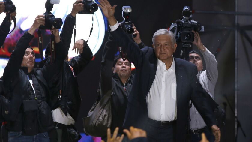 Andres Manuel Lopez Obrador waves to supporters as he arrives to Mexico City's main square, the Zocalo, on July 1, 2018.