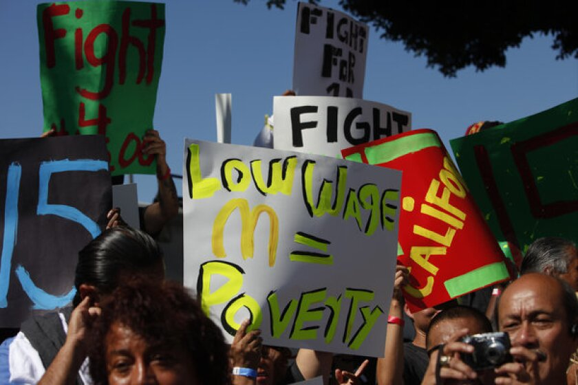 Fast-food workers and supporters organized by the Service Employees International Union (SEIU) protest in Los Angeles in an effort to put pressure on the industry to raise wages.