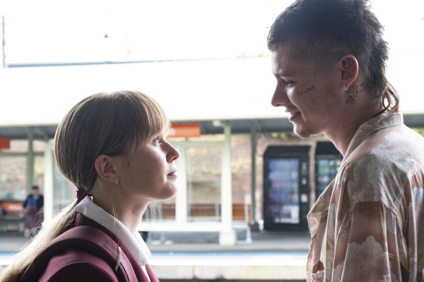 """This image released by IFC Films shows Eliza Scanlen, left, and Toby Wallace in a scene from """"Babyteeth."""" (IFC Films via AP)"""
