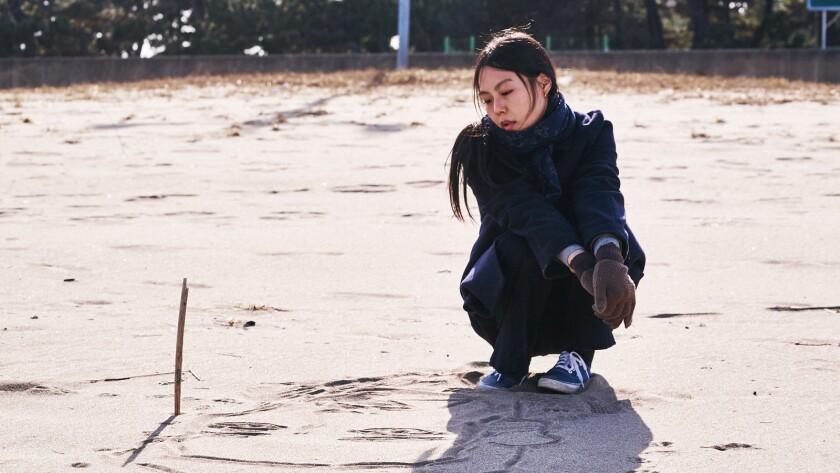 "Kim Min-hee in the Korean drama ""On the Beach at Night Alone."""