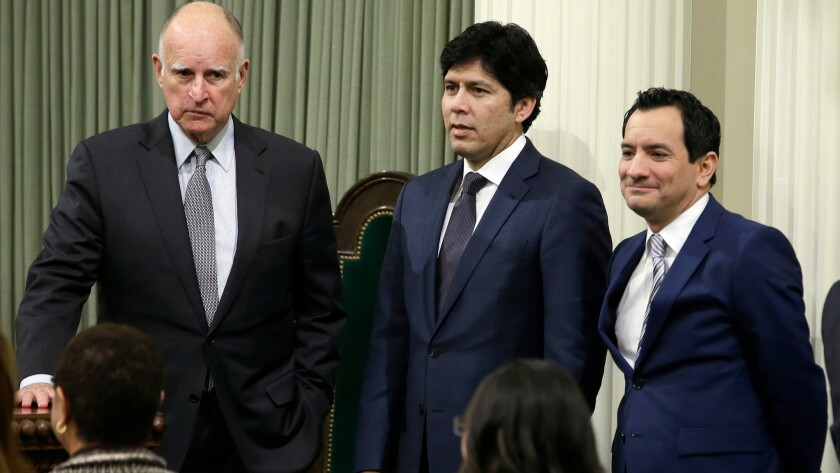 California Gov. Jerry Brown (left), Senate President Pro Tem Kevin de León, D-Los Angeles (center), and Assembly Speaker Anthony Rendon, D-Paramount (right), are seen after Rendón was sworn-in as speaker of the Assembly in Sacramento, Calif. on March 7.