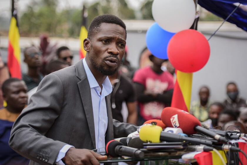 """Ugandan opposition figure Bobi Wine, whose real name is Kyagulanyi Ssentamu, speaks at a press conference in Kampala, Uganda Monday, Feb. 22, 2021. Wine says he will withdraw a legal petition that sought to overturn the victory of President Yoweri Museveni in last month's presidential election, charging that Uganda's courts are filled with """"yes-men"""" appointed by Museveni and that he did not expect a fair decision from the panel of nine judges. (AP Photo/Nicholas Bamulanzeki)"""