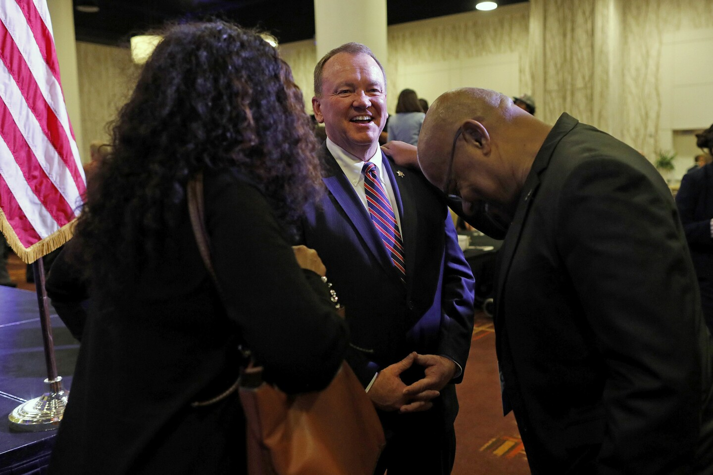 Sheriff Jim McDonnell, center, enjoys a laugh with Kim Evans, left, of Signal Hill, and Jesse Johnson, of Los Angeles, on election night at the JW Marriott Los Angeles L.A. LIVE.