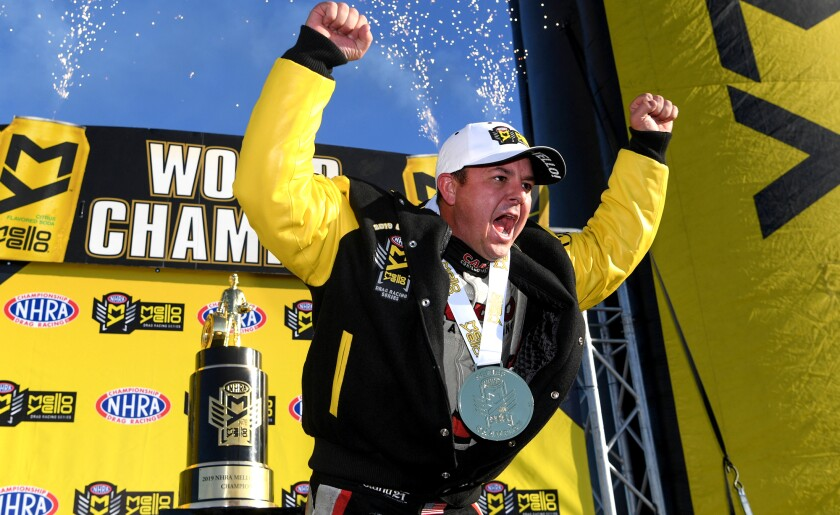 Drag racer Steve Torrence celebrates after repeating as the NHRA's top fuel champion on Nov. 17, 2019, at Auto Club Raceway in Pomona.