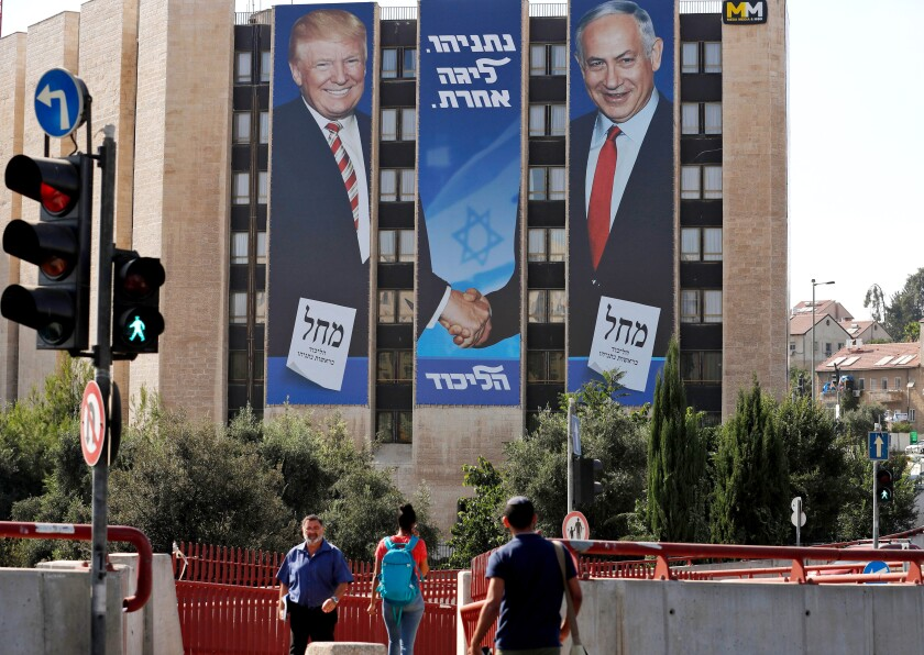 A 2019 election banner in Jerusalem shows Israeli Prime Minister Benjamin Netanyahu shaking hands with President Trump