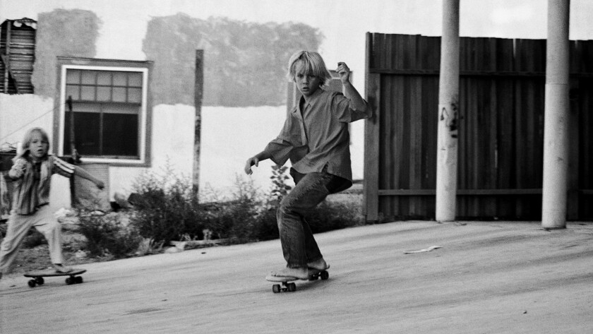 Future skateboarding legend Jay Adams riding a clay wheeled Hobie skateboard barefoot as a young boy.