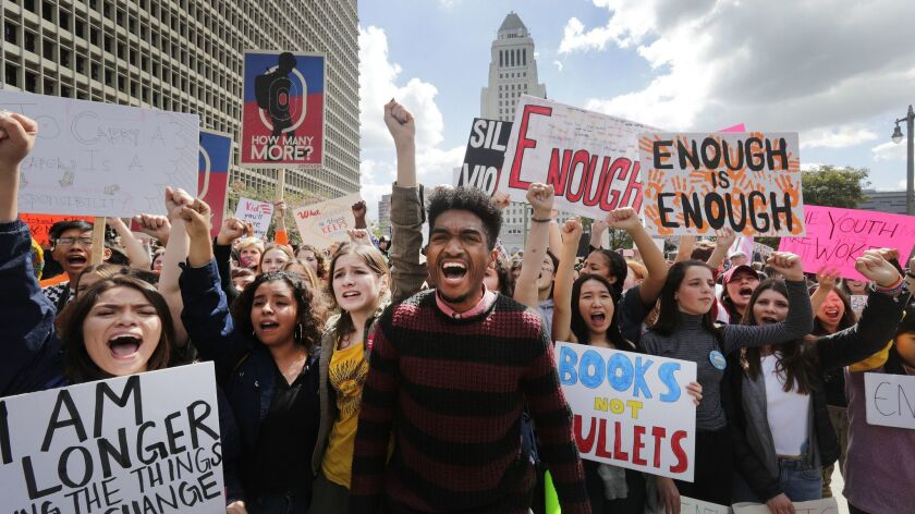 Students lead a chant against gun violence as thousands of protesters march in the streets during the March for Our Lives on March 24 in Los Angeles.