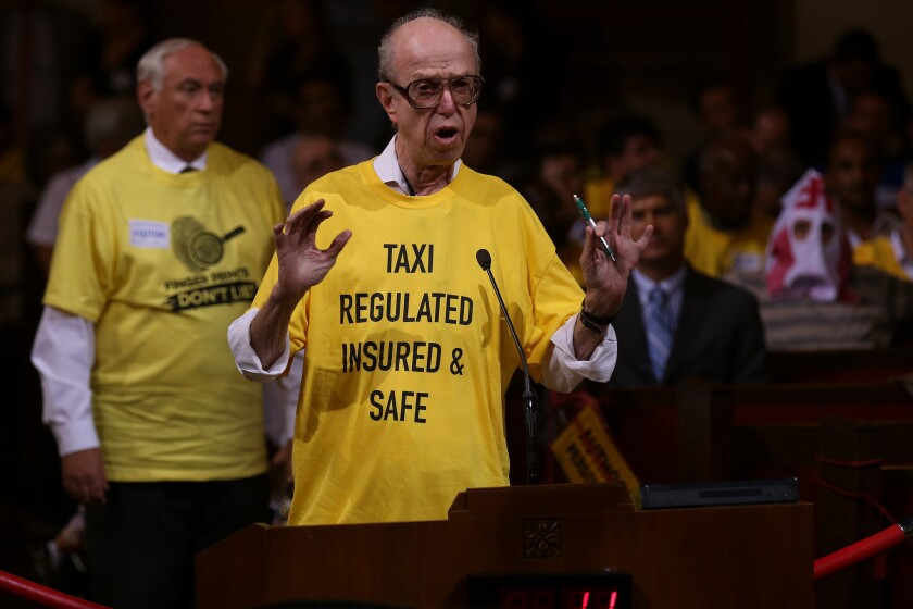 David Shapiro, right, founder of United Independent Taxi (drivers) Inc., expresses discontent with Uber at a Los Angeles City Council meeting in August.