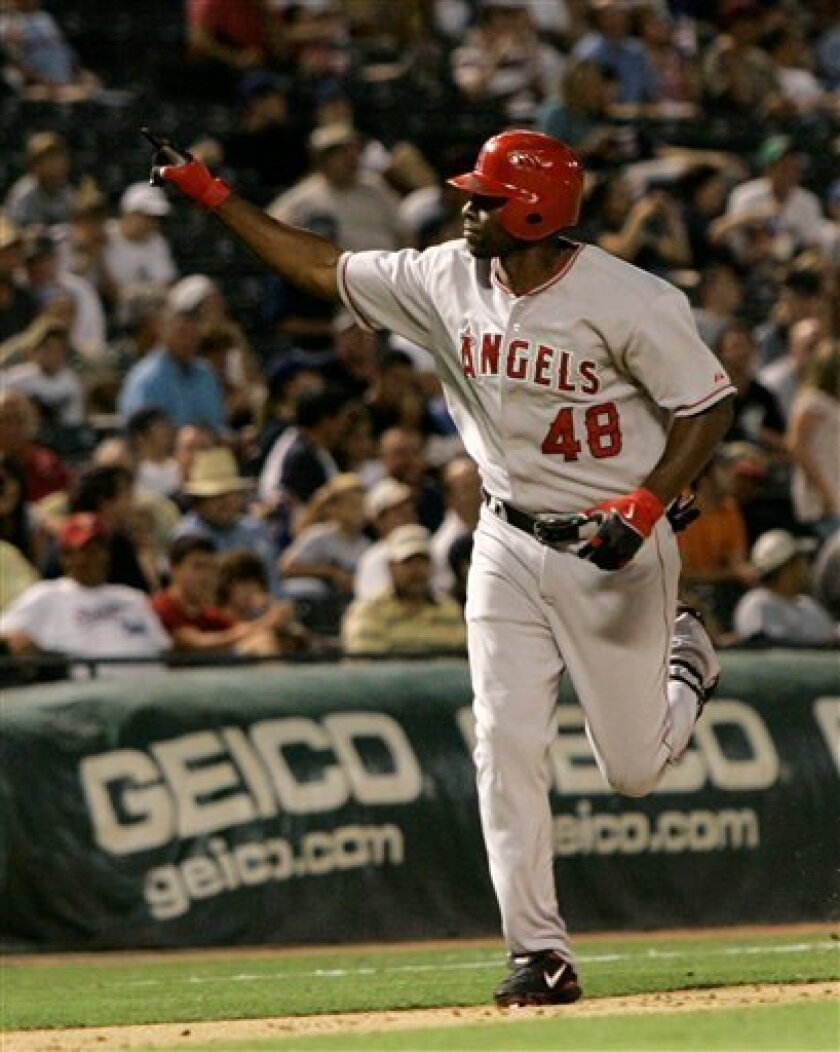 Los Angeles Angels' Torii Hunter points towards the stands as he comes home after hitting a solo home run, his second of the game, in the seventh inning against the Texas Rangers during a Major League Baseball game, Monday, July 7, 2008, in Arlington, Texas. (AP Photo/Tony Gutierrez)