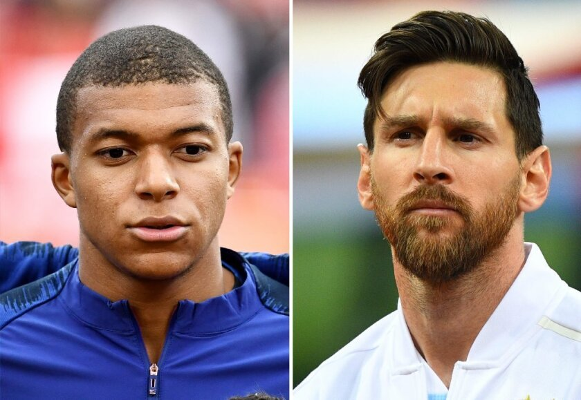 Kylian Mbappe (i) y Lionel Messi (d).