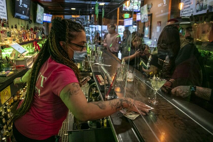 Bartender Christina Flintland serves drinks at Elvie's Public House.