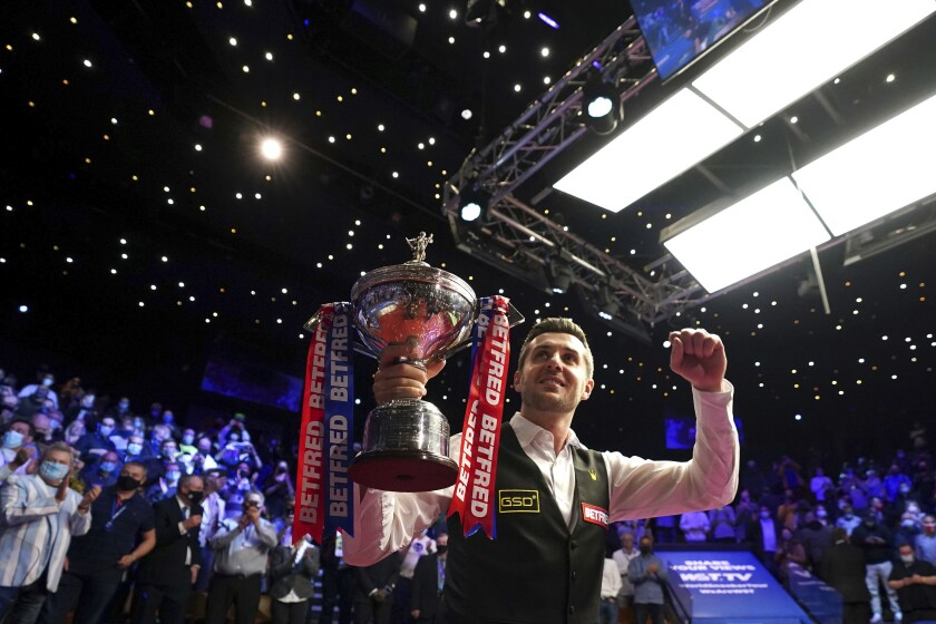 England's Mark Selby celebrates with his trophy after winning the World Snooker Championships at the Crucible Theatre in Sheffield, England, Monday, May 3, 2021. (Zac Goodwin/PA via AP)