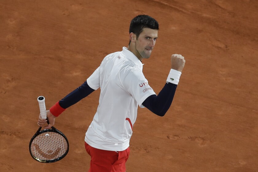 Novak Djokovic clenches his fist after scoring a point against Pablo Carreno Busta.