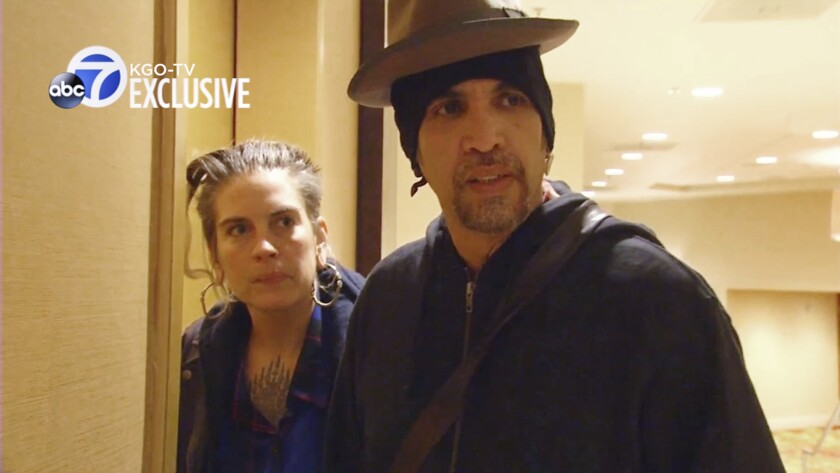FILE - This file photo from exclusive video provided by San Francisco TV station KGO-TV, made late Sunday, Dec. 4, 2016, shows Derick Ion Almena, right, and Micah Allison, the couple who operated the Ghost Ship warehouse where dozens died in a fire, at an Oakland, Calif., courthouse. Almena, facing a second trial after a 2016 fire killed 36 partygoers at a San Francisco Bay Area warehouse he's accused of illegally converting into a cluttered artists enclave, is expected to plead guilty later this month, relatives of several of the victims said. Almena, 50, is expected to plead guilty to 36 counts of involuntary manslaughter on Jan. 22, 2021. (KGO-TV via AP, File)