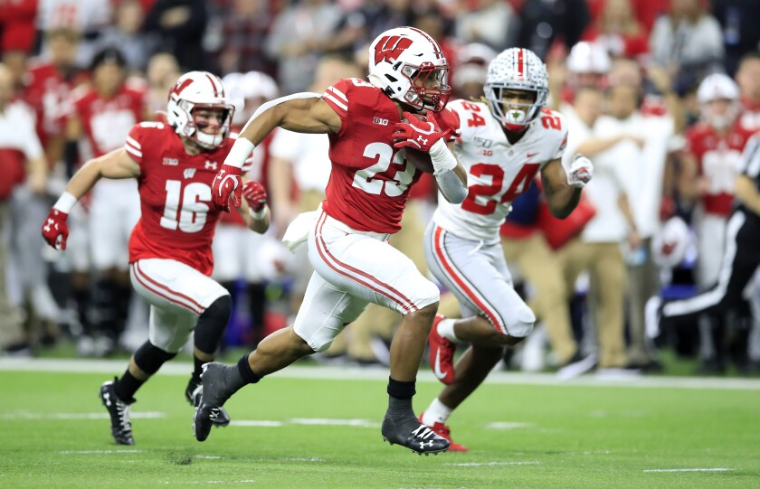 Wisconsin running back Jonathan Taylor carries the ball against Ohio State.