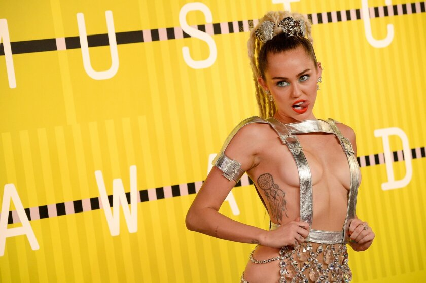 Host Miley Cyrus attends the 2015 MTV Video Music Awards at Microsoft Theater in Los Angeles, California.