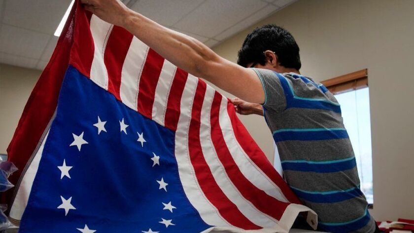 A worker folds a newly made Betsy Ross flag at a business in Salt Lake City, Utah, on July 5.