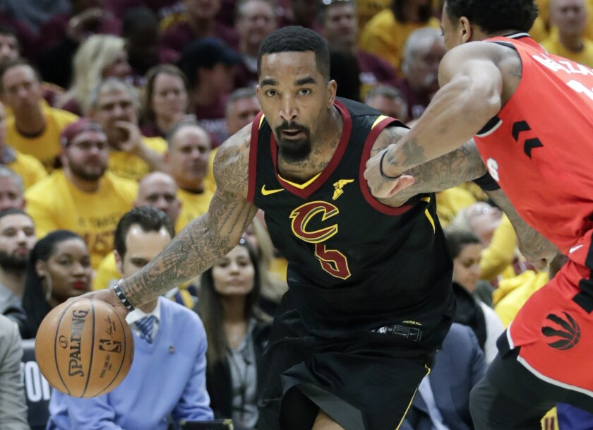 JR Smith drives past DeMar DeRozan during a game between the Cavaliers and Raptors.