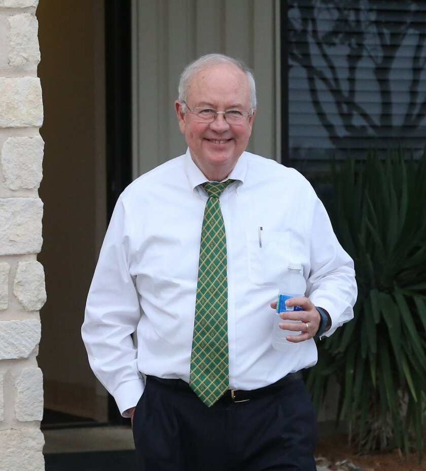 Baylor President Ken Starr leaves a terminal at a Waco airport Wednesday, May, 25, 2016, in Waco, Texas. Baylor University officials say regents are still reviewing an investigation into how the Texas school handled reports of rape and assault by football players and expect to announce any actions