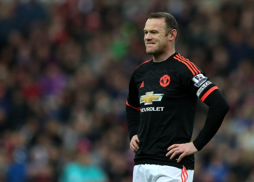 Manchester United's captain Wayne Rooney stands dejected as Sunderland's Wahbi Khazri celebrates his goal during the English Premier League soccer match between Sunderland and Manchester United at the Stadium of Light, Sunderland, England, Saturday, Feb. 13, 2016. (AP Photo/Scott Heppell)