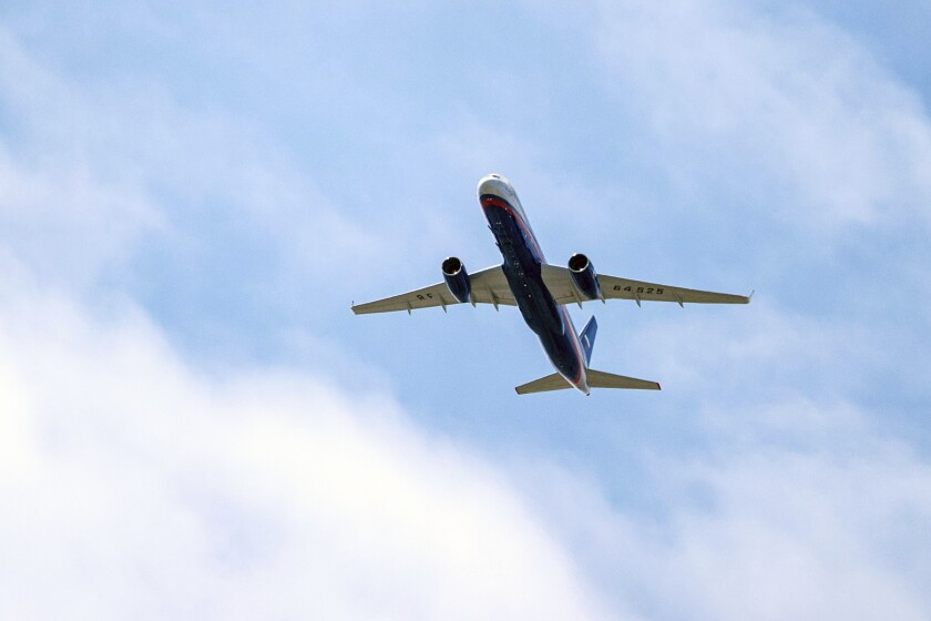 FILE In this file photo taken on Friday, April 26, 2019, A Russian Air Force Tu-214 flies over Offutt Air Force Base, Friday, April 26, 2019, in Omaha, Neb. The flight is allowed as part of the Open Skies Treaty. The Russian upper house the Federation Council debate and vote on the withdrawal from an international treaty allowing surveillance flights over military facilities following the U.S. departure from the pact. (Chris Machian/Omaha World-Herald via AP, File)