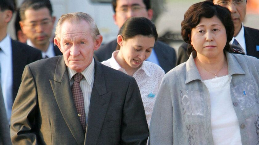 Former U.S. Army deserter to North Korea Charles Jenkins, left, escorted by his wife, Hitomi Soga, right, and their daughter Mika, center, arrives at Tokyo's Haneda International Airport in 2004.