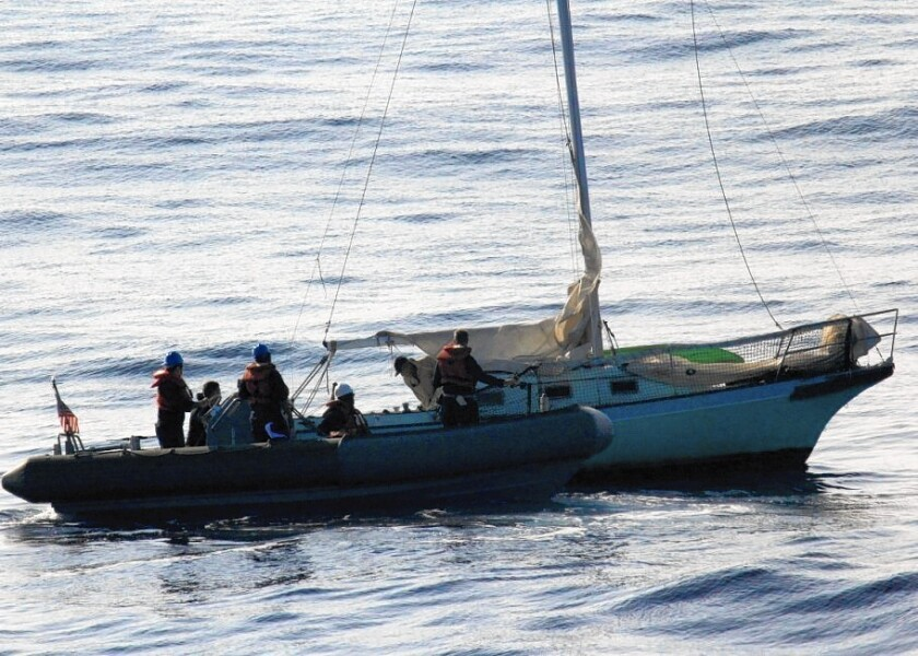 Members of the U.S. Navy rescue Ron Ingraham off Hawaii.