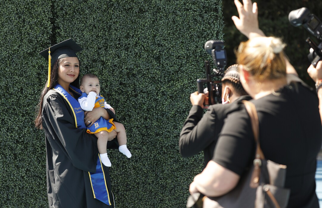 Kimberly Sanchez, 22, poses for photos holding her 6-month-old baby Alessandra Burnashkin