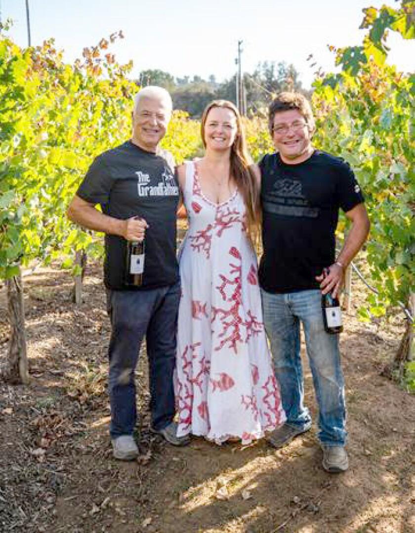 Alfredo Gallone, left, and his daughter Raffaella Gallone-Sepe with her husband Alberto Sepe operate Principe di Tricase Winery & Highland Valley Christmas Tree Farm.