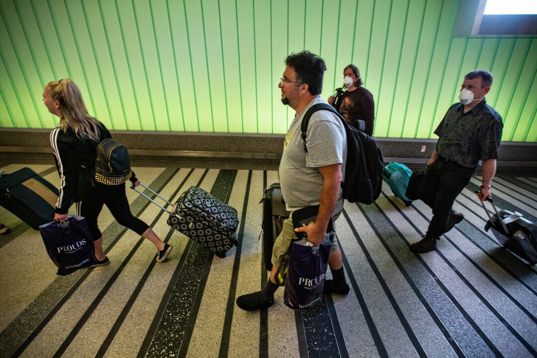 Travelers pass through Tom Bradley International Terminal at LAX