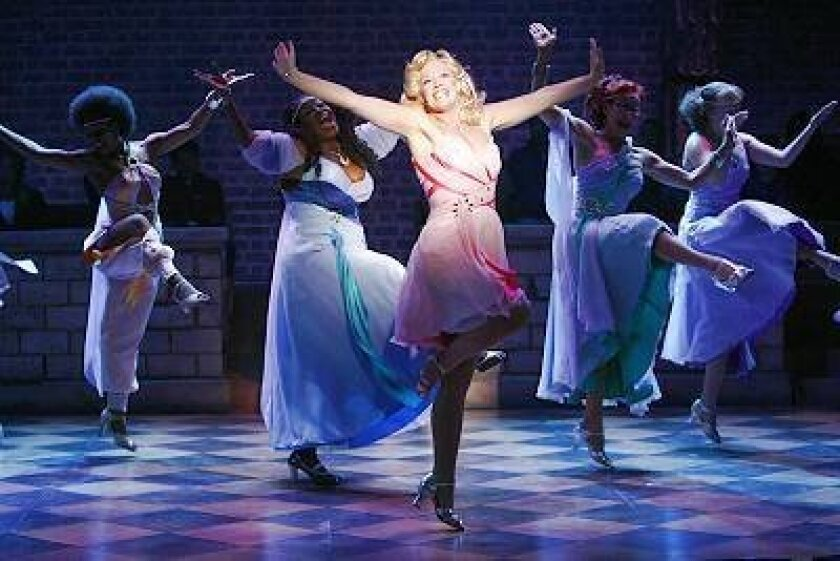 """Kira (Elizabeth Stanley) vamps it up with her mythological sisters in the musical """"Xanadu."""""""