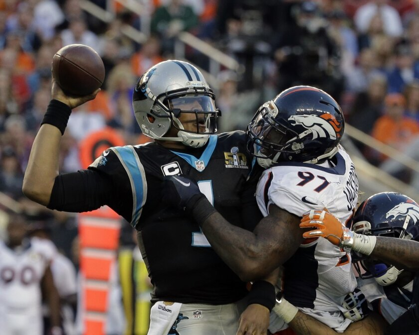 Carolina Panthers' Cam Newton (1) tries to throw with Denver Broncos' Malik Jackson (97) defending during the first half of the NFL Super Bowl 50 football game Sunday, Feb. 7, 2016, in Santa Clara, Calif. (AP Photo/Gregory Bull)