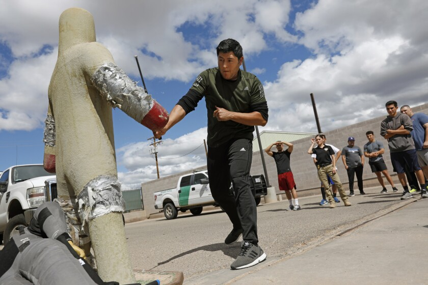 Trainee Jose Avalos learns defensive tactics in the El Centro Sector's Border Patrol citizens' academy.