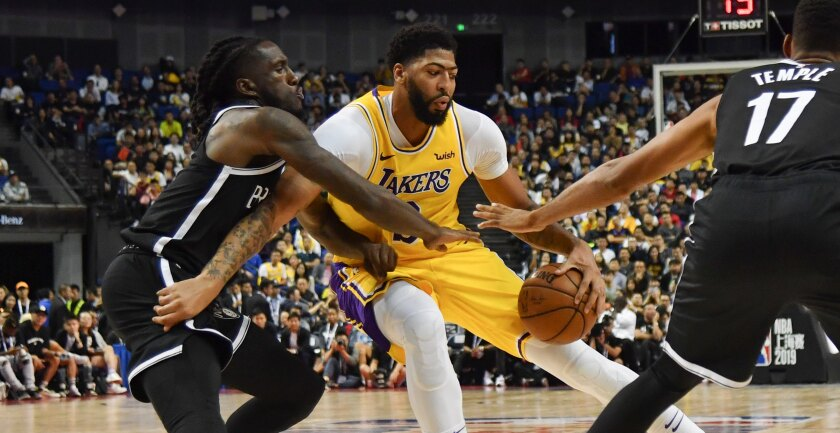 Lakers forward Anthony Davis looks to score against Nets forward Taurean Prince during the game Thursday night in Shanghai.