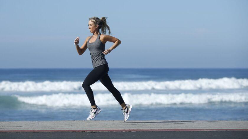 Sheri Matthews Kimmel runs on the beach in Cardiff.