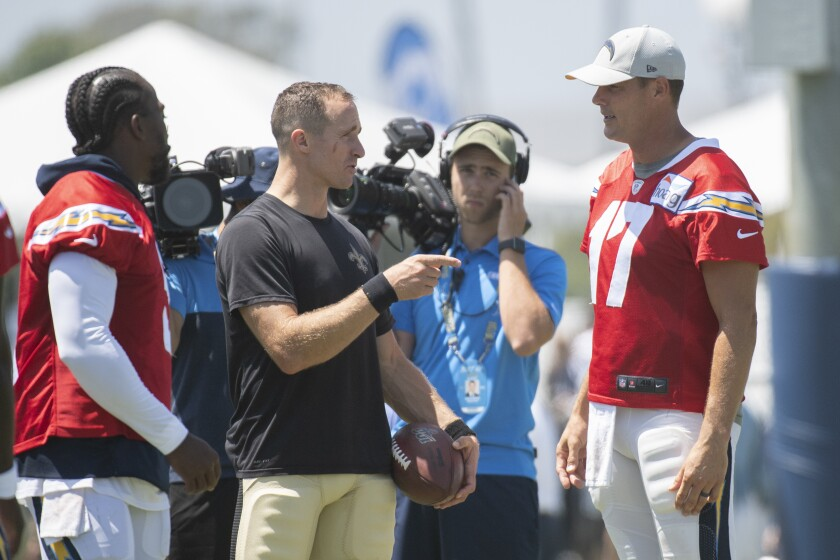 New Orleans Saints quarterback Drew Brees chats with Los Angeles Chargers quarterback Philip Rivers.