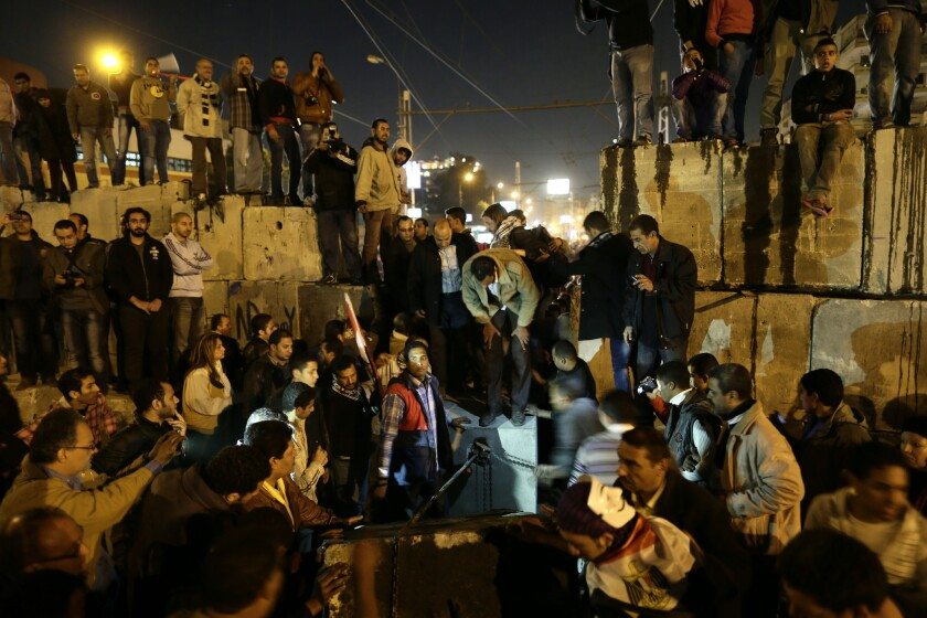 Thousands of opponents and supporters of Egypt's Islamist president staged rival rallies in the nation's capital Tuesday, four days ahead a nationwide referendum on a contentious draft constitution.