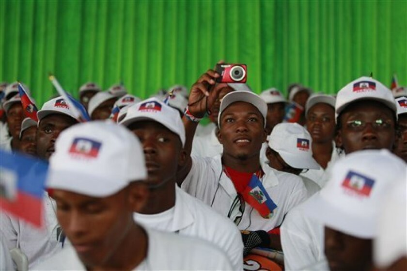 A Haitian student takes a picture during a ceremony welcoming the students to Dakar, Senegal Wednesday, Oct. 13, 2010. Senegal is one of the poorest countries in the world and its GDP is only marginally higher than Haiti's, but that didn't stop the government from going ahead with a plan to offer a