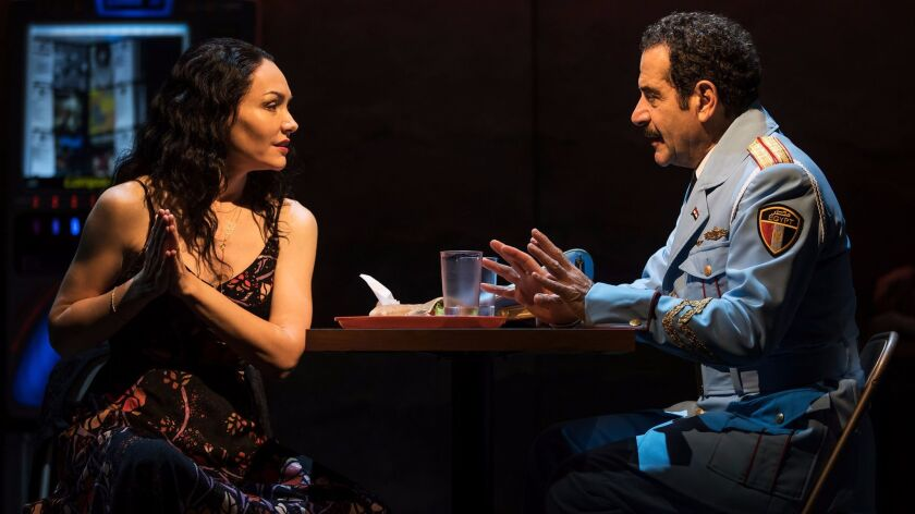 "(L-R) - Katrina Lenk and Tony Shalhoub in a scene from ""The Band's Visit."" Credit: Matthew Murphy"