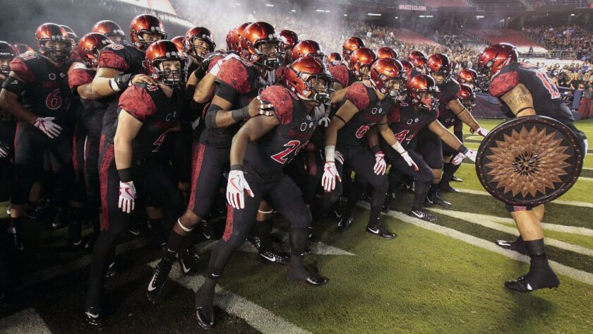 SAN DIEGO, September 16, 2017 | The Aztecs get pumped up after coming out of the smoke filled inflat