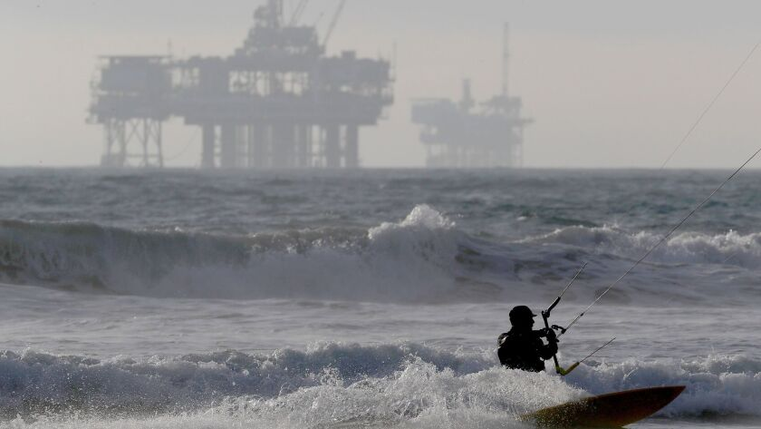 Offshore oil drilling platforms can be seen off the California coastline from Huntington Beach.