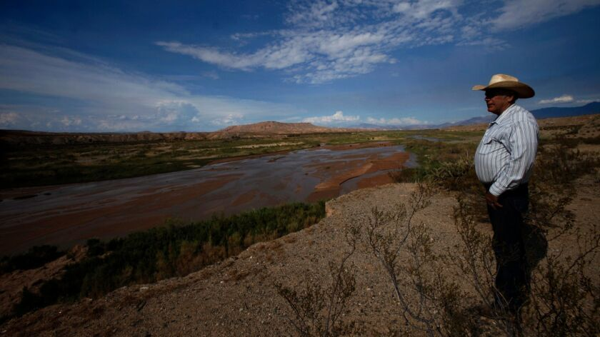 BUNKERVILLE, NV - AUGUST 20, 2013 -- Rancher Cliven Bundy, 67, looks over the Virgin River on some o