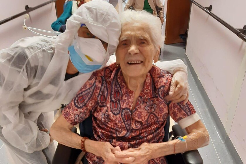 In this photo taken on April 1, 2020, 103-year-old Ada Zanusso poses with a nurse at a convalescent home in Lessona, northern Italy, after recovering from a COVID-19 infection. Zanusso credits her recovery to courage and faith, the same qualities that have served her well in her nearly 104 years on Earth. The new coronavirus causes mild or moderate symptoms for most people, but for some, especially older adults and people with existing health problems, it can cause more severe illness or death.