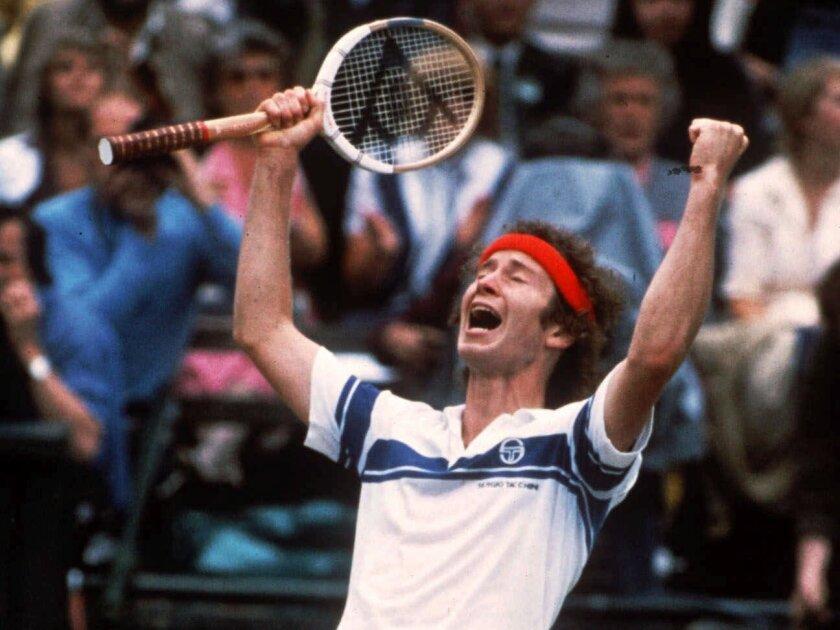 John McEnroe celebrates after defeating Bjorn Borg at Wimbledon in 1981.
