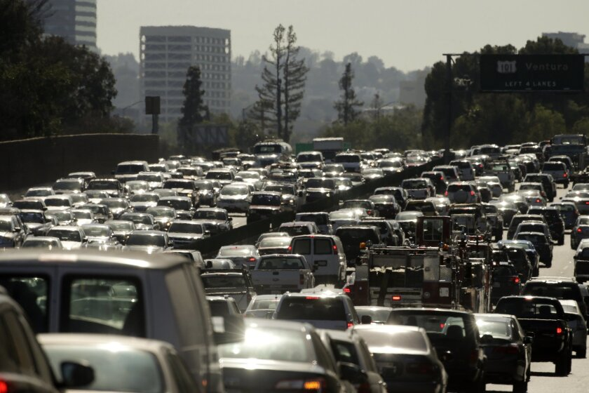 In this Wednesday, May 20, 2015 photo, traffic slowly moves along the 101 Freeway during afternoon rush hour in Los Angeles. Traffic congestion is projected to become significantly worse and more widespread without big changes in how people and products get around. The possible solutions are many, but none is easy or cheap. (AP Photo/Jae C. Hong)