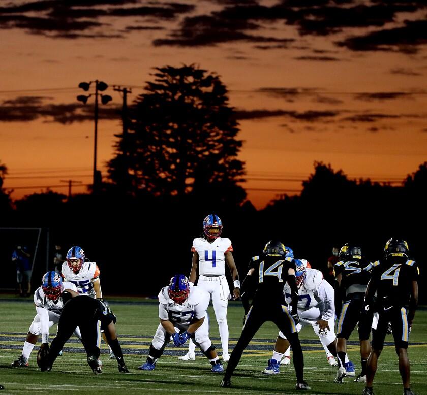 Serra plays Warren as the sun sets on Friday night. Warren is one of 68 unbeaten football teams.